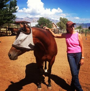 Claire Ann Barr-Johnson, of Horses for Healing,  with Phoebe, a 9-year-old Quarter Horse, who is sporting a fly mask.
