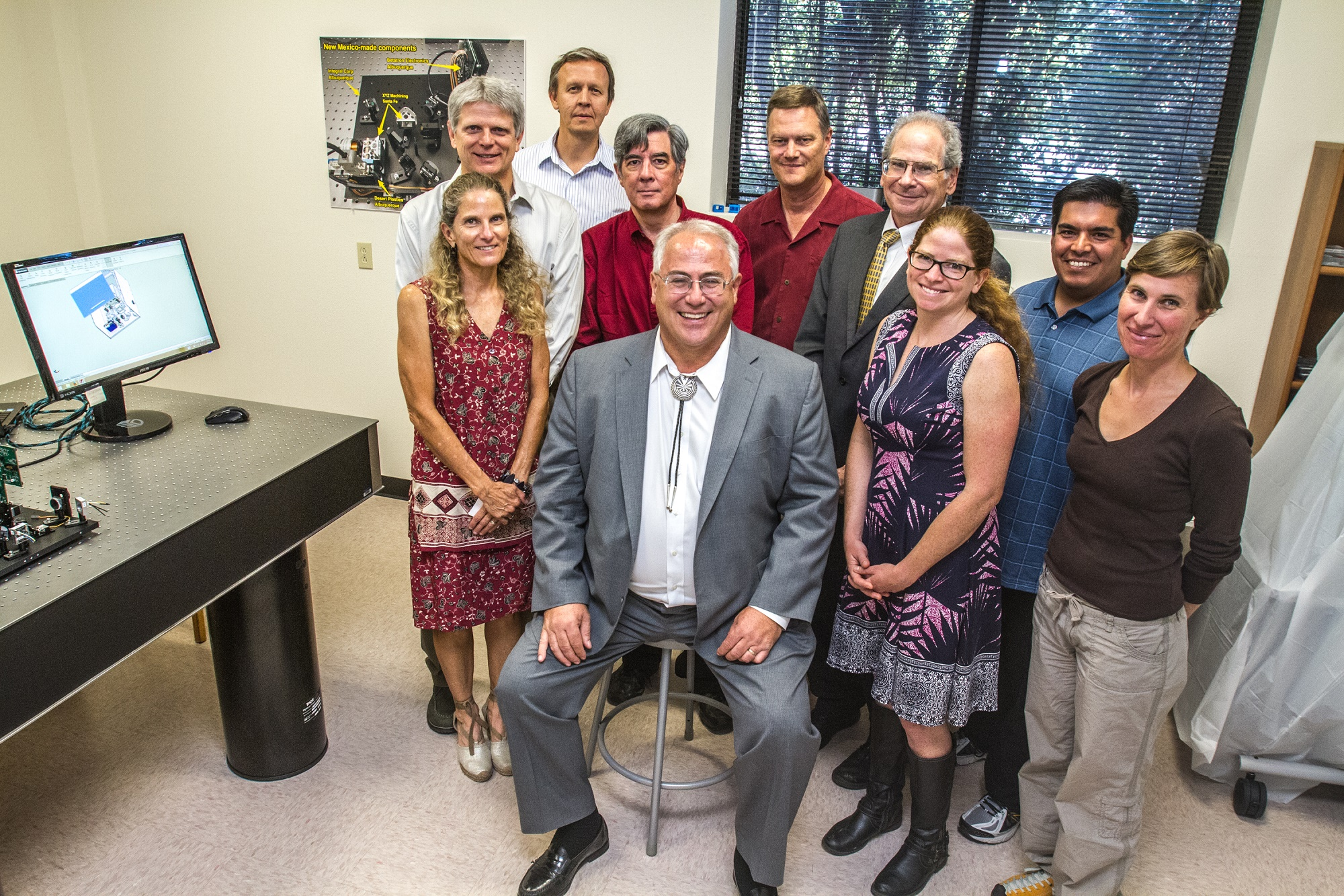 The staff of Santa Fe-based Mesa Photonics, which was recognized as a 20/20 company in 2013. Santa Fe Mayor Pro Tem Peter Ives is seated. Photo by Jane Phillips.