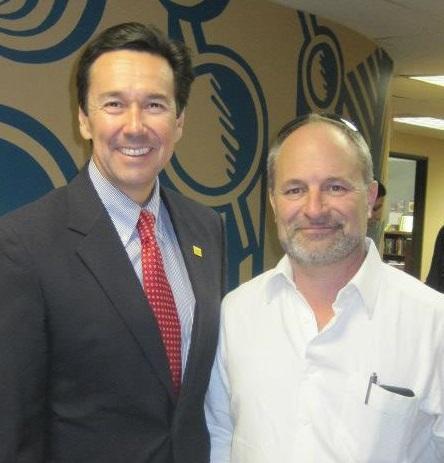 Karl Halpert, right, with New Mexico Economic Development Department Cabinet Secretary Jon Barela