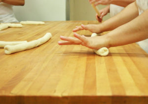 Rolling pizza dough
