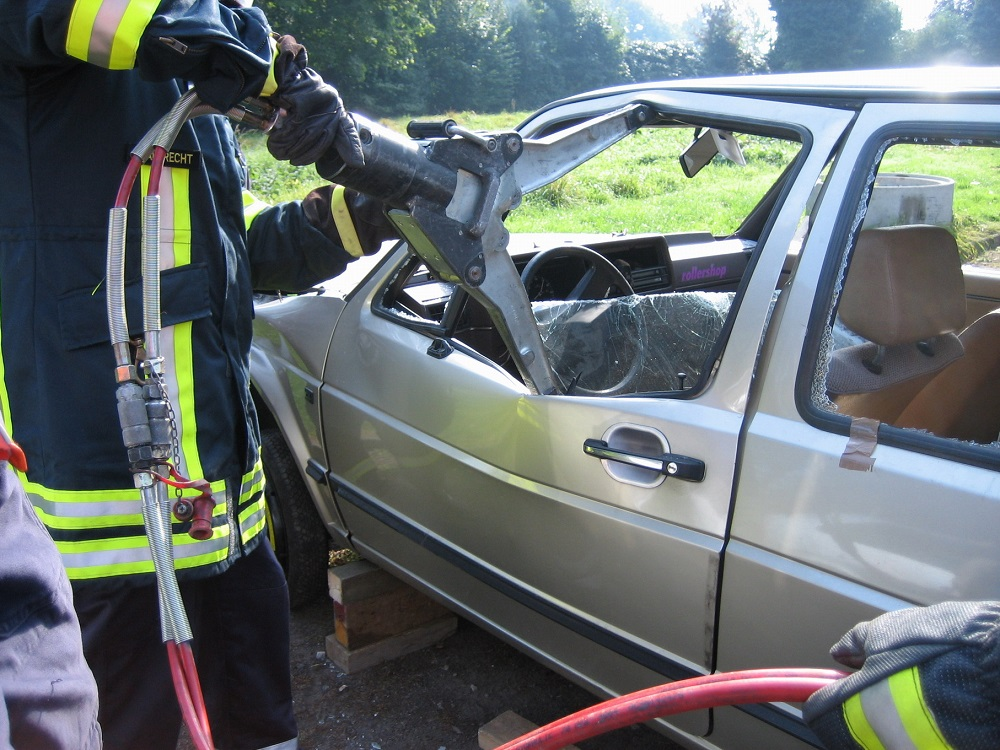 Firefighters training on extracting crash victims from a car wreck
